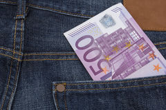 Euro (EUR) in a pocket. 500 Euro (EUR) note in the  pocket of a pair of blue jeans Royalty Free Stock Images