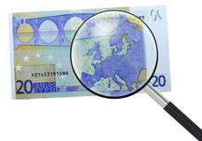 Euro, Europe under magnifying glass. The state of the Euro,and Europe in general, is under scrutiny.  Concept Stock Photo