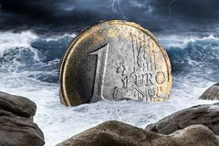 Euro european currency crisis concept. Euro european currency crisis one coin inflation finance market crash concept sinking in ocean thunderstorm background royalty free stock photography