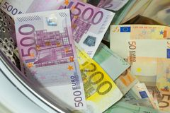 Euro / European currency, high denomination in the washing machine, money laundering concept. Euro / European currency, high denomination in the washing machine royalty free stock image
