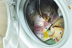 Euro / European currency, high denomination in the washing machine, money laundering concept. Euro / European currency, high denomination in the washing machine royalty free stock images
