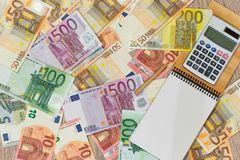 Euro, European money, various denominations a notebook and calculator in which you can write something. Euro, European money, various denominations a notebook royalty free stock image