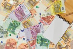 Euro, European money, various denominations a notebook in which you can write something. Euro, European money, various denominations a notebook stock photos