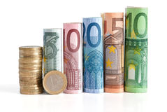Euro fatture e moneta rotolate Fotografia Stock
