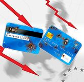 Euro financial crisis. Damaged bank cards and red arrows concept Royalty Free Stock Photo
