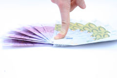 Euro and finger Royalty Free Stock Photo