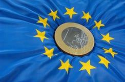 Euro on flag. A one-euro-coin on a european flag Royalty Free Stock Photos
