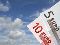 Euro flying high. Euro notes on sky background Royalty Free Stock Photo