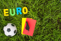 Euro football championship - image with ball, referee yellow, red card on green lawn. Symbol of soccer and fair play Stock Photography