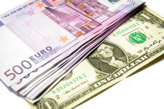 500 euro geldbankbiljetten tegenover 1 dollar stock afbeeldingen