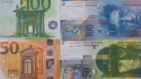 Euro 100 Geldhintergrund 50 Schweizer Franken Stockbild