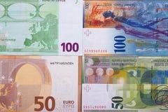 Euro 100 Geldhintergrund 50 Schweizer Franken Stockfotografie