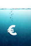 Euro go down. Sinking euro symbol, 3d render Royalty Free Stock Images