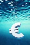 Euro go down. Sinking euro symbol, 3d render Royalty Free Stock Photo