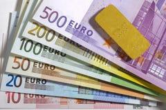 Euro and gold bar. Euro banknotes and gold bar stock images