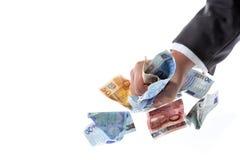 Euro grabber 01. Two hands grab some euero cash notes Stock Photos