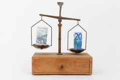 Euro and Greek drachma on a scale Stock Images