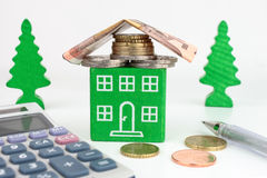 Euro Green Home. A green home with Euro money for the roof, representing savings to be made with an energy efficient home Royalty Free Stock Image
