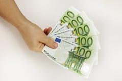 Euro in hand Stock Photos