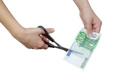 Euro. Hand cutting the banknote of 100 euro Stock Image
