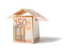 Euro house. House built from euro bills isolated on white background Stock Photography