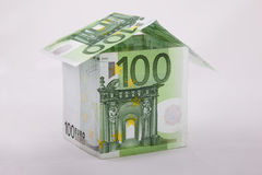 Euro house. Small house built of several one hundred euro bills. Isolated on white background Stock Photography