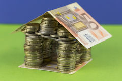Euro house. House built with European money over green background grass and sky cobalt Royalty Free Stock Photography