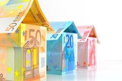 Euro Houses. Various sized houses with banknotes from 10 to 50 Euro on white background Royalty Free Stock Images