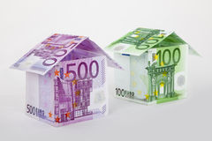Euro houses. Two colorful houses built of different euro bills. Isolated on a white background Stock Image