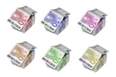 Euro Houses. Six 10 Euro bills shaped into miniature houses, each a different color.  Isolated on white background Royalty Free Stock Photos
