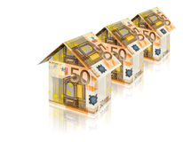 Euro houses. Three houses built of euro bills with reflection on white Stock Photos