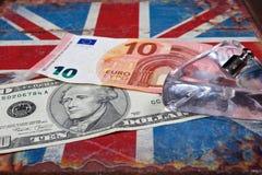 Euro i amerykański dolar na Brytyjski flaga Zdjęcie Stock