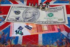 Euro i amerykański dolar na Brytyjski flaga Obrazy Stock