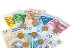Euro i nowi połysku złoty banknoty z monetami zdjęcie stock