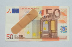 The euro ill treated by a patch Royalty Free Stock Image