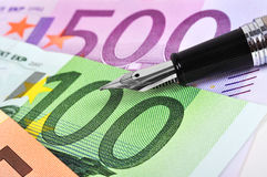 Euro and ink pen Royalty Free Stock Image