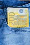 200 Euro in a jeans pocket. 200 Euro banknote in a jeans pocket Royalty Free Stock Photos