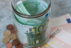 Euro. Keeping euro money in glass jar Royalty Free Stock Images