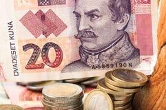 Euro 20 Kuna Bill do dinheiro e moedas Imagem de Stock