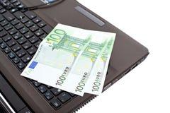 Euro on laptop Stock Photography