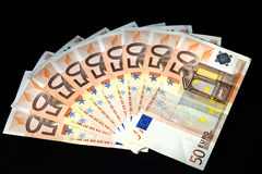 50 Euro. A lot of european money over black background Stock Photo