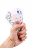 Euro- mão da terra arrendada de dinheiro Fotografia de Stock