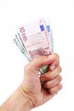Euro mano della giacenza monetaria Fotografia Stock