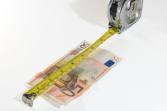 Euro Measurement concept success. Yellow measuring tape and Euro money. Conceptual to success Royalty Free Stock Photography