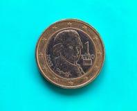 1 euro- moeda, União Europeia, Áustria sobre o azul verde Fotos de Stock Royalty Free