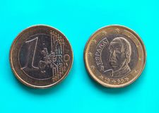 1 euro- moeda, União Europeia, Espanha sobre o azul verde Fotografia de Stock Royalty Free