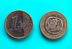 1 euro- moeda, União Europeia, Grécia sobre o azul verde Imagens de Stock Royalty Free