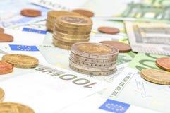 Euro- moedas e cédulas do dinheiro Fotografia de Stock Royalty Free
