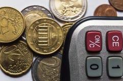 Euro- moedas e calculadora Fotos de Stock Royalty Free