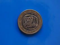 1 euro moneta, Unione Europea, Grecia sopra il blu Fotografia Stock Libera da Diritti